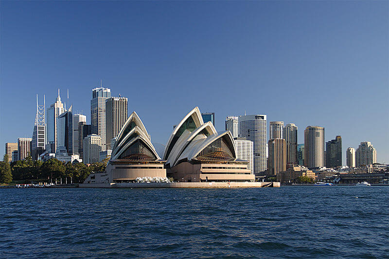 The Sydney Opera House viewed from the water with the city skyline behind (Australia)