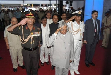 President A.P.J. Abdul Kalam stands in salute at Mahim Station - Photo courtesy Reuteurs