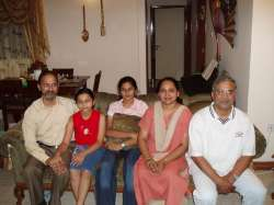 Dad, his cousin and family