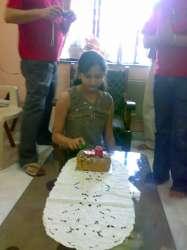 Alisha cutting her cake